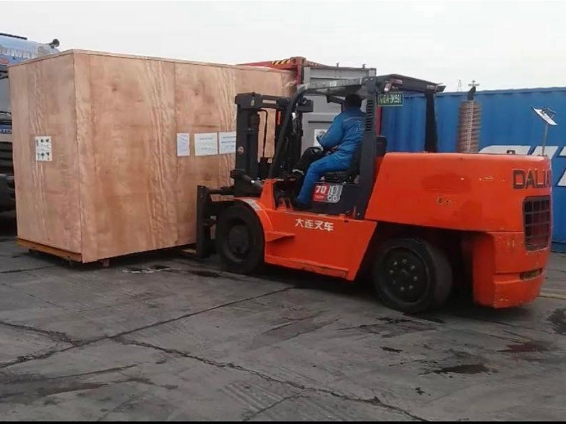 Load the gable top carton filling machine at the port