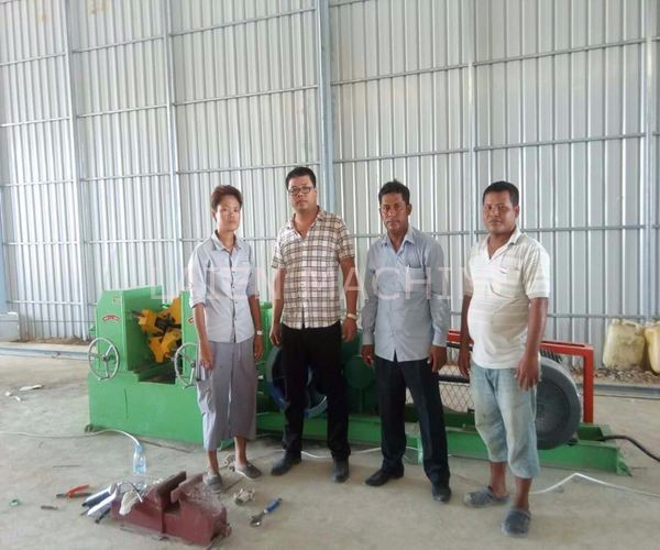Our technicians help Cambodia customer to install and debug mesh welding machine