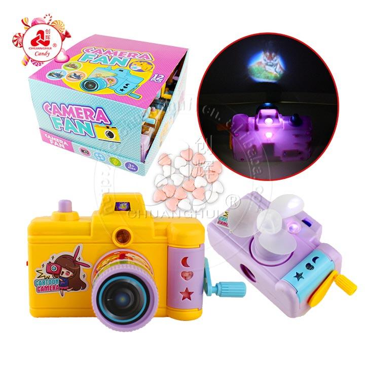 โคมไฟกล้องของเล่นกล้องฉายมัลติฟังก์ชั่นมือสั่นพัดลม LED ขนมของเล่น