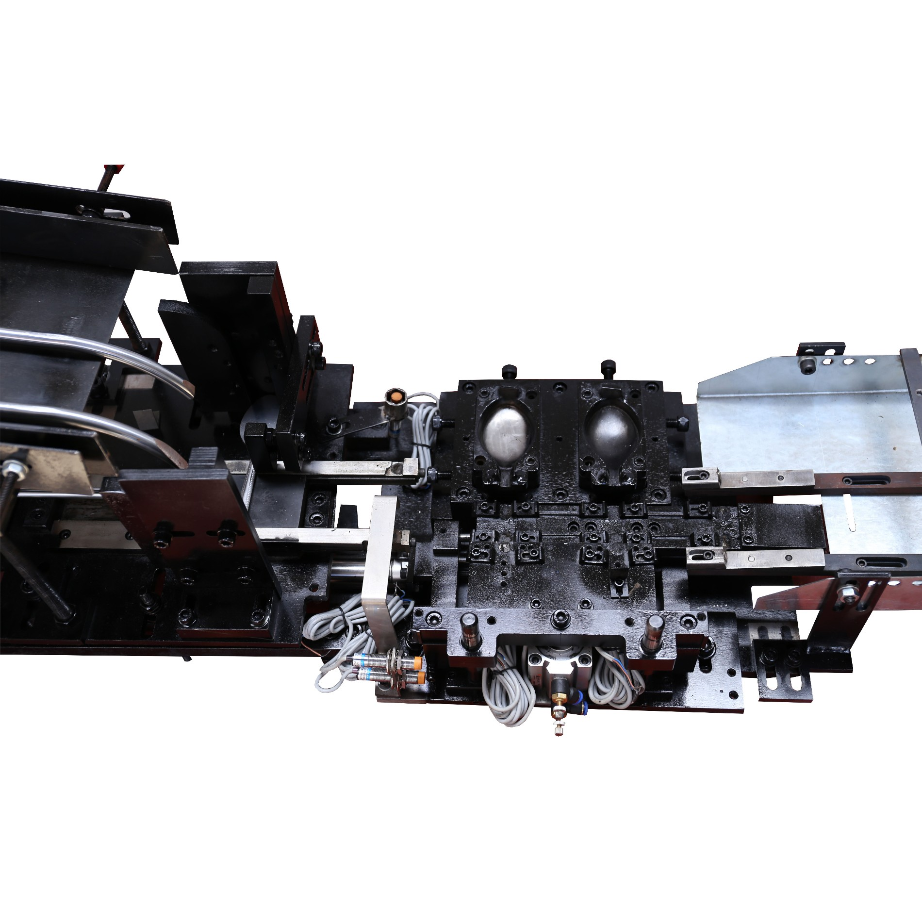 Alimentador automático para la fabricación de cubiertos