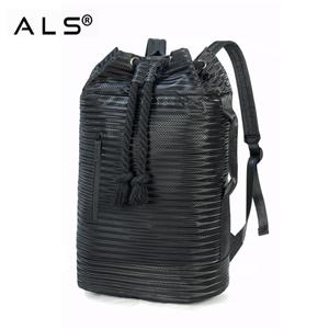 Functional barrel type drawstring backpack