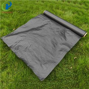 Landscape Fabric Under Grass Roll Using