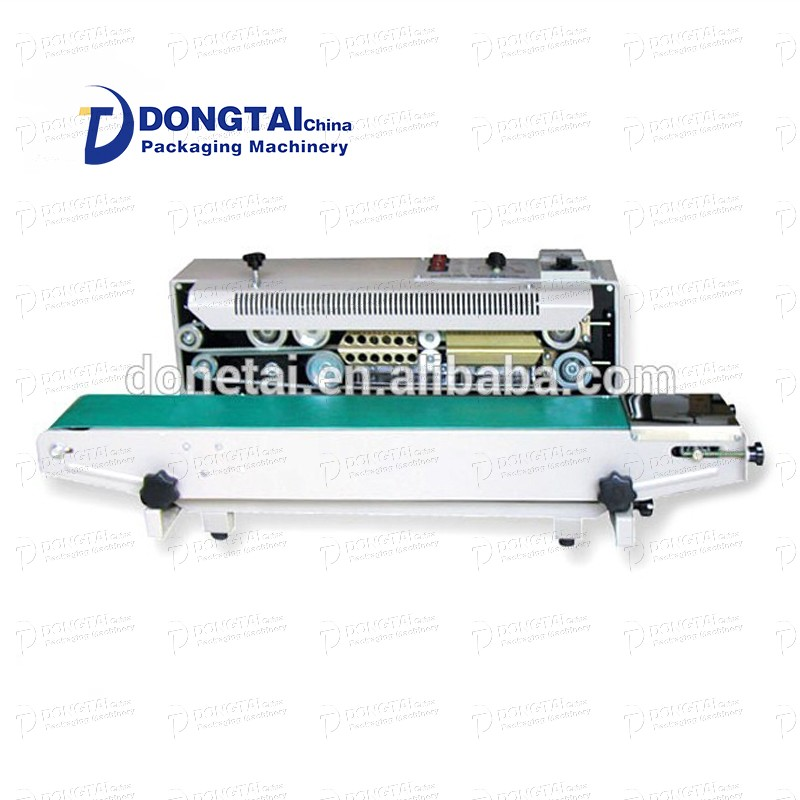 Multifunctional plastic bag liquid filling and sealing machine