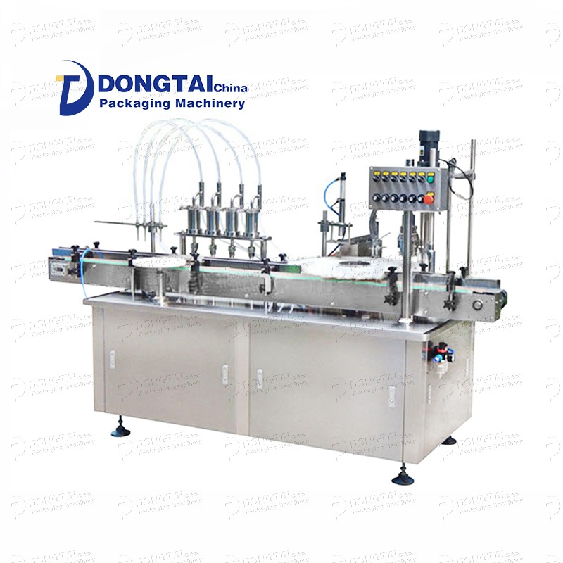 Small automatic liquid filling and capping machine