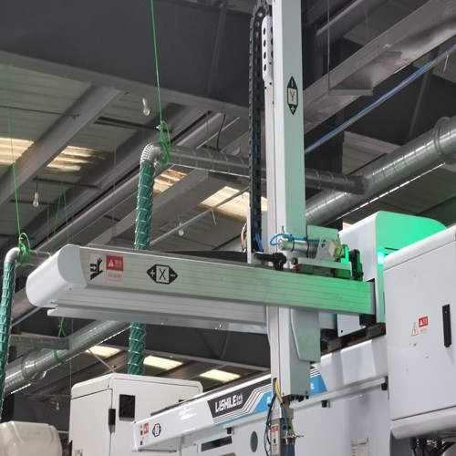 Which industries are the injection molding machine robots used in?