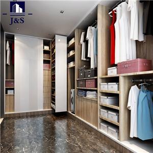 Large walk in wardrobe closet design for women