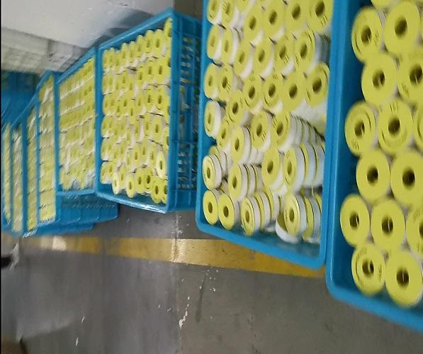 Producción de cinta de rosca de PTFE área de apilamiento semiacabado.jpg