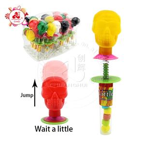Spring Bounce Skull toys with pressed candy jumping toy