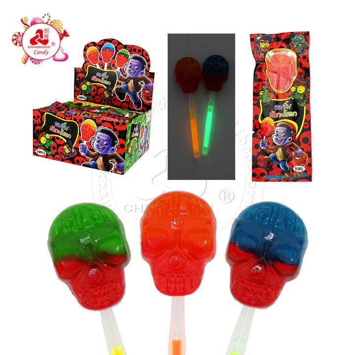 Bonbons d'Halloween saveur de fruits mélangés tête de mort sucette fluorescente rougeoyante