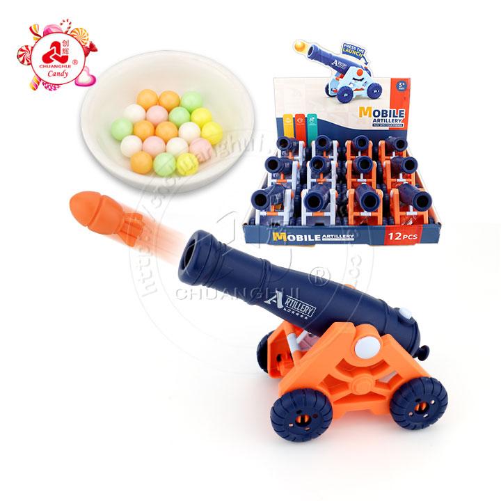Appuyez sur le canon à balles de lancement jouet d'artillerie mobile jouet de bonbons