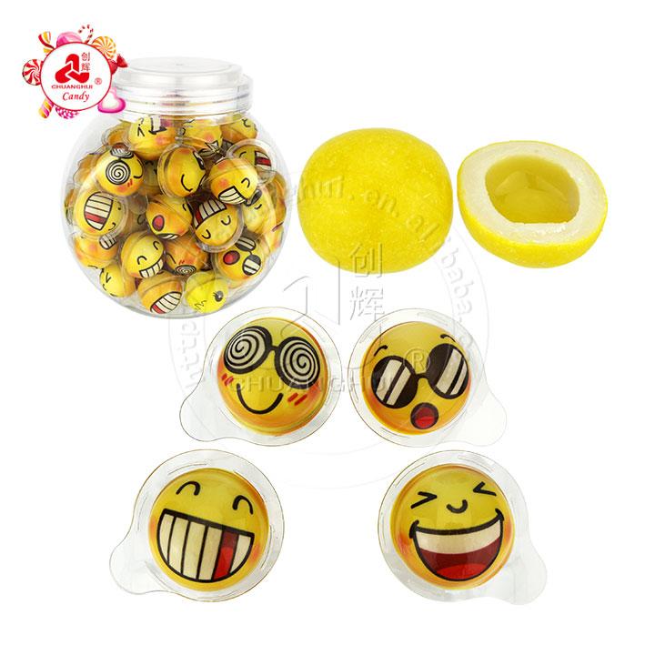 Cara de emoticon que empaqueta la goma de mascar La mermelada de la fruta llenó la bola de la goma de mascar