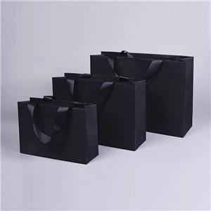 Bolsas de regalo de papel marrón con asas