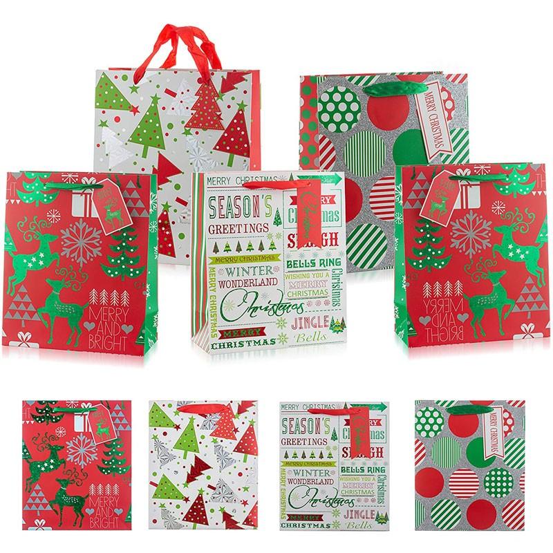 Bolsas de regalo de papel navideñas con asas