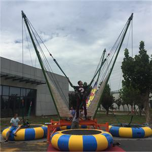 Children outdoor bungee jumping trampoline rides 4 persons for sale