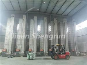 A customer factory with a vertical layout of fish feed production line