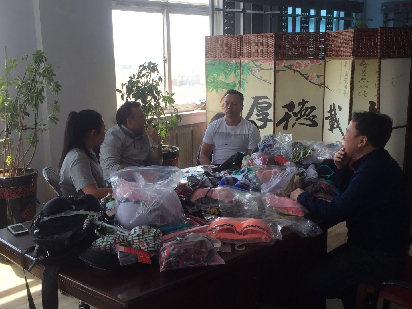 Colombian customers come to the factory to purchase swimwear and other related products