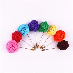 Homemade flower-shaped brooch by satin ribbon