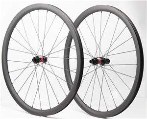 Wide tubeless bike carbon wheels for gravel 35mm deep 28mm wide 12mm thru axle with DT Swiss 240s hub