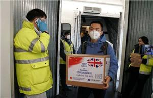 Chinese team and equipment arrive in UK to support virus fight, fight the coronavirus together.